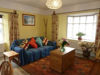 Living room with plenty of comfortable seating, large Freesat TV and DVD player, i pod/MP3 dock