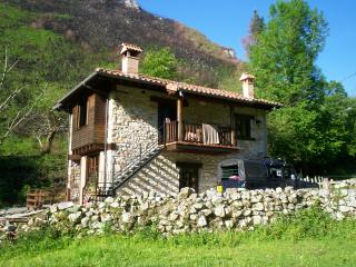 the house with orchard and river has oodles of space and privacy to have a perfect family holiday