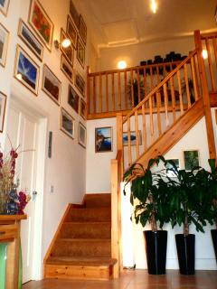 Full height entrance hall decorated with panoramic photographs