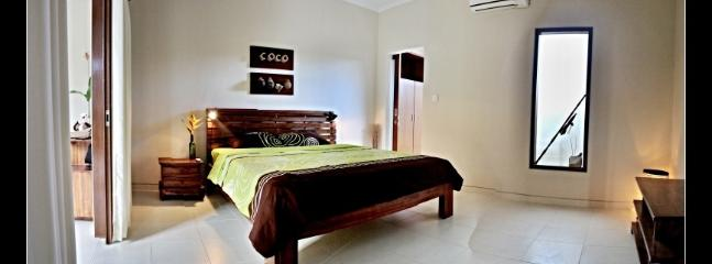 COCO bedroom with king size bed, AC and ensuite bathroom