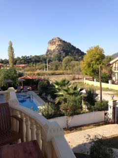 View from upstairs balcony towards the Acropolis mountain in Caunos