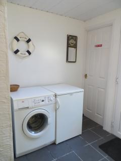 Utility room with washing machine at Sunny Harbour Holiday Cottage, Polperro