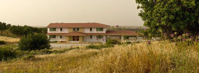The villa - divided into four suites - in a quiet rural setting