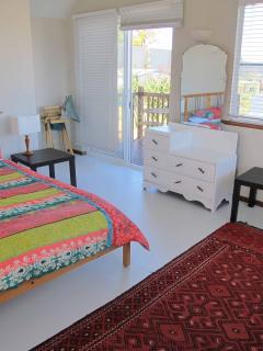 Roomy upstairs bedroom/parents retreat featuring ensuite and cute balcony - stunning ocean views
