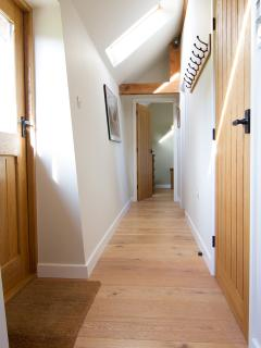 The hallway leads you to the bathroom, two bedrooms and the back door for easy access to the garden