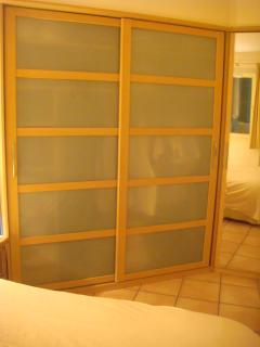 Extensive wardrobe and mirrored dressing area