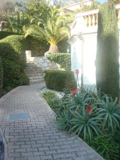 Pedestrian entrance and well maintained gardens