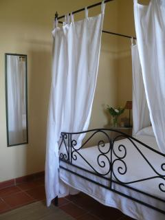 The bedroom with canopy bed