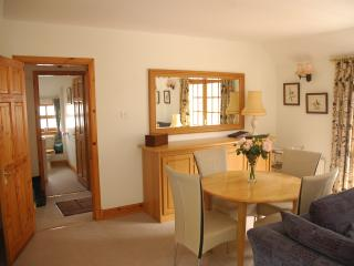 dining table within the bright sitting room