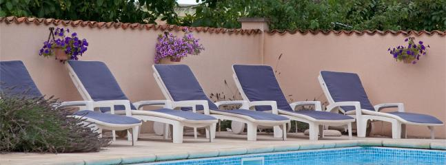 Sunbeds by the pool - Some of the many!