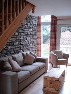 Sitting room with feature stone wall