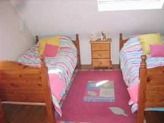 Upstairs Twin Bedroom, with good storage, bright room with TV and DVD player.
