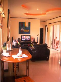 Lounge with satellite TV and patio doors to Private Pool