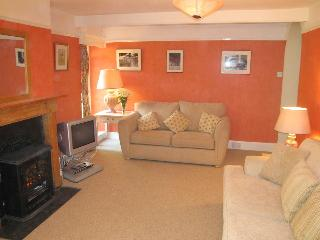 The sitting room has a  fireplace containing a 'woodburning effect' electric fire