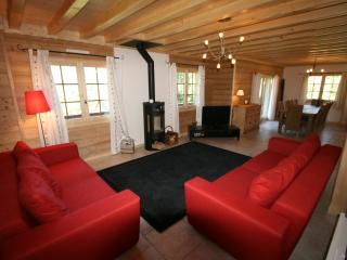 Enjoy the mountain views from the comfortable fabric sofas around the log burner and large TV