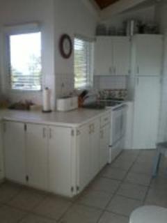 Kitchen Dishwasher and American size Fridge Freezer with good storage cupboards