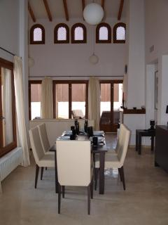 Interior view showing lounge / dining table and vaulted ceiling ( keeps villa cooler)