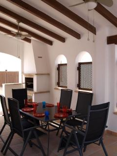 Dining table and barbecue in covered patio
