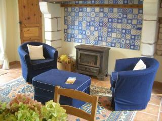 The cosy sitting room with its woodburning stove.