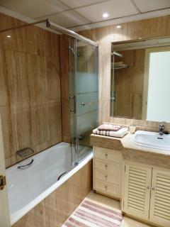 The fully equipped en-suite bathroom has a bath, with a shower.