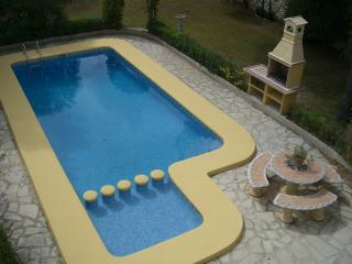 THE POOL,TODDLER POOL, BARBECUE AND ROUND STONE SEATING FROM TOP BALCONY