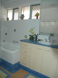 Modern Bathroom with bath, vanity & separate shower stall