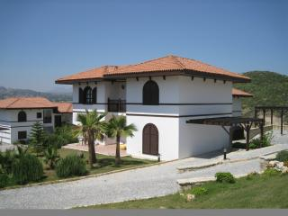 A side view of villa showing sun terrace and car port
