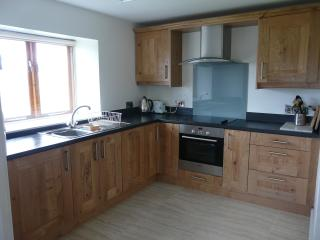 The kitchen has lovely oak units and is fully equipped for creative cooks! Amazing views