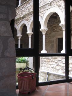View out to arched loggias leading to bedrooms and surrounding the ancient circular stone tower