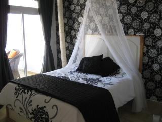 Our wonderful romantic main bedroom, fully air conditioned with patio doors leading to the balcony