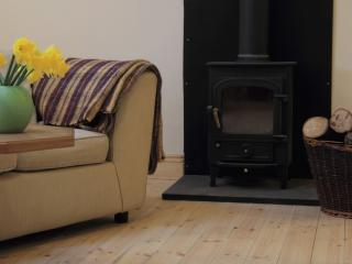 Cosy woodburners in each living area, with a supply of firewood from our own woodland