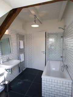 Bathroom incorporating a bath tub/shower.