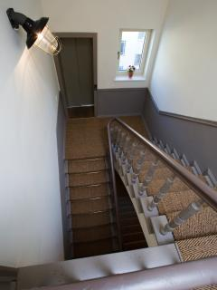Staircase and lift to the apartments.