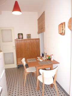 Breakfast Table and Cupboard with Cutlery, Bowls, Dishes, Glasses, Cups, Coffee Maker, Cheese Grater