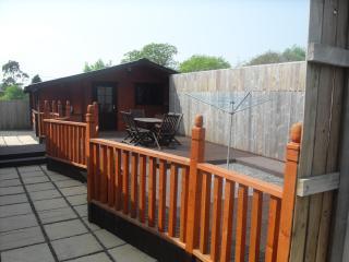 Rear - decked patio area etc..