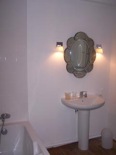 Bathroom First Floor.Electic towel rail, loo, and bath with hand shower.