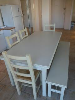 Large dinner table conveniently located near the kitchen