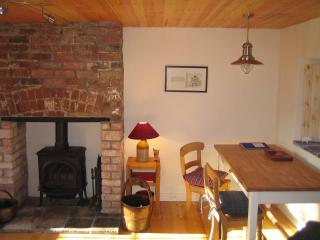 Cosy living room stove and farmhouse dining table.