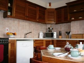 The kitchen is  equipped with fridge/freezer,cooker,dishwasher,micro-wave & all essential untens