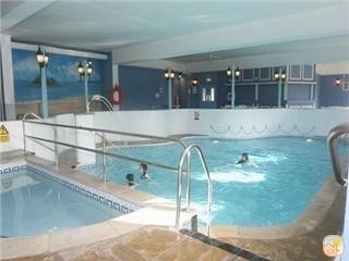 A warm indoor swimming pool with baby pool for pure fun or relaxation