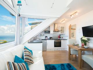 Open plan Lounge / Kitchen / Dining area with far reaching views over the Harbour and Bay.