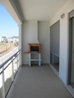 The large balcony with built in BBQ