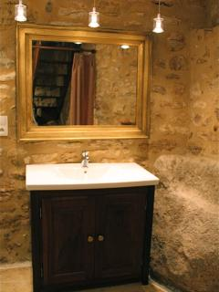 Ensuite bath to Louis XV bedroom with exposed rock formation