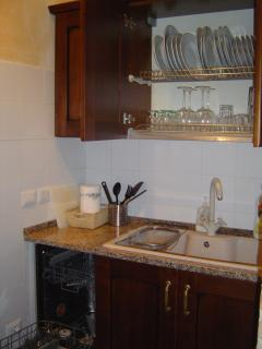 Sink and dishwasher and plenty of cabinets.