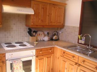 The upper, first floor apartment kitchen is  fully equipped and next to the sitting room diner.