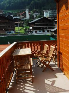 Balcony with tennis courts beyond