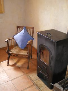 A quiet reading corner by the woodburner
