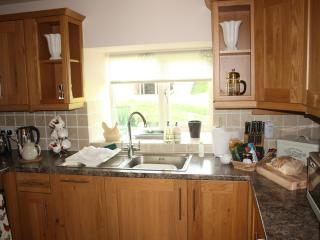 Well fitted kitchen with oak fitted units and integrated appliances