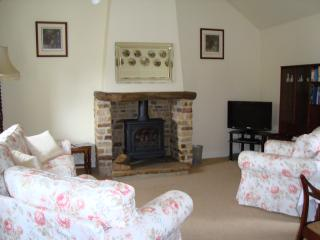 Living room featuring Yorkstone fireplace with gas fired log burner