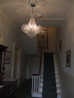 Gorgeous stately hall, with chandeliers and pictures of old Ramsgate